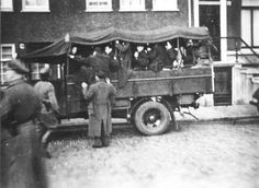 Amsterdam, Holland, Jews captured in the first round-up taken to a truck, 22-23/02/1941. .authorities arrested over 400 Jewish youths. They were gathered in the Old Jewish Quarter, abused for a long time and then sent to Buchenwald and Mauthausen Concentration Camps. Within months all of them were murdered except for one.