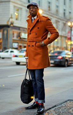 Joseph's outfit stood out to me from the masses for his use of hues. Not only do his bright red socks offer an unexpected flash of color, combined with his orange pea coat they make a powerful statement. Unlike New Yorkers, who so often first reach for black fabrics, Chicagoans have a well-documented love affair with using color in their wardrobes. Chicago.