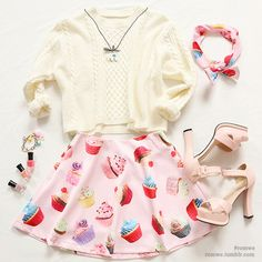 Cute and quirky holiday outfit with the creme sweater, pastel heels, and cupcake skater skirt.