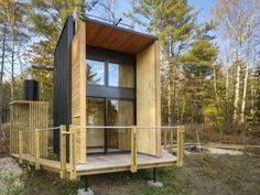 Modern off-grid cabin built by father & son goes back to basics