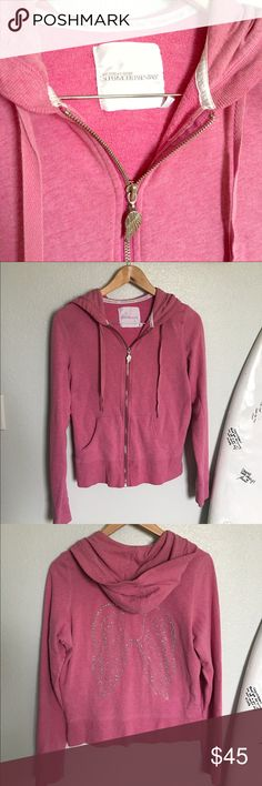 Victoria's Secret Angel wings zip up jacket Pink zip up supermodel essentials jacket in size L. Fits like a M to me. Angel wings on back. Victoria's Secret Sweaters