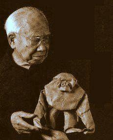 Japanese Origami artist, Akira YOSHIZAWA (1911~2005), with his art.