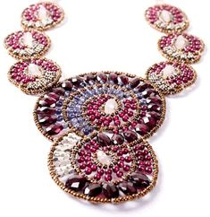 Wearable art: this unforgettable necklace, $545, is handmade in Italy of garnet, pink quart and iolite. limited edition. Click here for details: http://www.salangonline.com/nshellgarnet.html