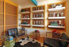 modern family room by Benedict August. A great idea for my sons GI Joe collection! Toy Art, Gi Joe, Dorm Room Themes, Regal Display, Trophy Display, Vintage Display, Modern Family Rooms, Lilly Pulitzer, Teen Girl Rooms