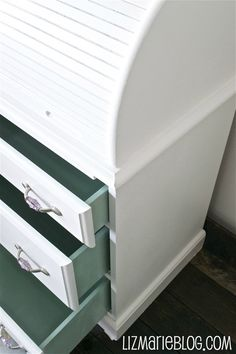 Roll-top desk makeover.  I have one of these that is in desperate need of an update.  I must do this!  I'm loving the pop of color on the sides of the drawers.  Very unexpected and pretty!