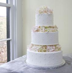 An elegant white floral wedding cake. Cake # 013.