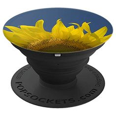 Yellow Sunflower and Blue Sky Floral - PopSockets Grip The flowery Yellow Sunflower and Blue Sky Floral PopSocket Grip features a botanical photograph of a yellow garden sunflower blossom on a summer day with a bright blue sky in the background. It makes a perfect little gift idea for a flower lover, gardener or florist. Collapsible grip provides a secure hold for easier texting, calling, photos, and selfies. #sunflowers #popsockets #cellphoneaccessories  #cellphoneholders Sunflower Gifts, Yellow Sunflower, Diy Gifts, Best Gifts, Handmade Gifts, Diy Pop Socket, Pop Sockets Iphone, Farewell Gifts, Florists