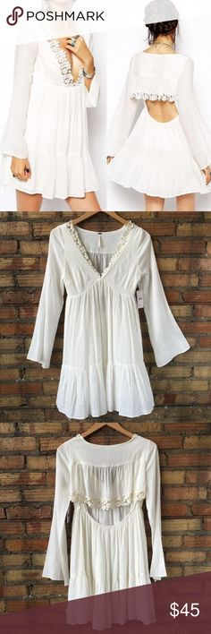 NWT Free People Gardenia Lace Open Back boho dress So pretty! Boho chic! Wear with a tank underneath and leggings in the fall! There is a snag on the left shoulder where the lace is. I took a picture of it. Free People Dresses