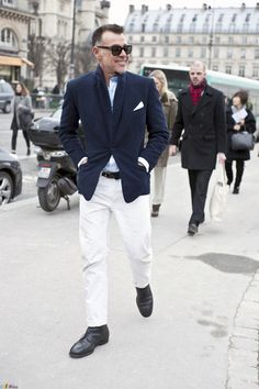 Navy jacket and white pants.