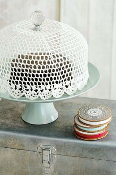 Crocheted top for a crystal glass cake cover Maybe my wonderful daughter could make me one?