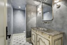 5578 Tilbury Drive Houston, TX 77056: Photo Pure elegance describes this Powder Room.  The French style cabinet has a polished nickel basin, custom glass mirror and delicate sconces.  The walls are detailed with a finely finished Venetian plaster and the floors are a honed patterned marble.