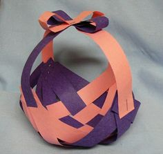 Who wants to come over to my house, have tea, and make a construction paper Easter basket like this?