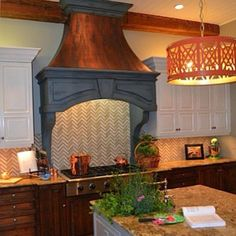 Swoon! Several of our products, including our Metallic Paint Collection in Copper colors, were used to create the stunning finish for this kitchen range hood. Gorgeous work by Patricia Presto of On The Surface!