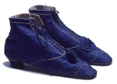Women's Evening Boots  c.1865  Royal blue cotton sateen boots with white stitching and trimmed with blue silk rosettes. Size: Length: 24 cm.