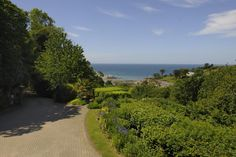 A superb manor house in an elevated position with spectacular panoramic sea views over Lee Bay, Devon