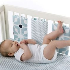 Crib rail guards that velcro on, as an alternative to a bumper. The set is over $60, but these would be easy to make.