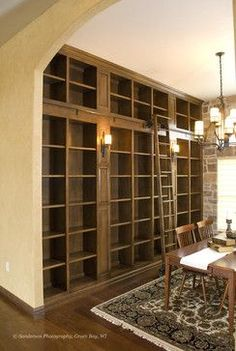 love a traditional study with lots of bookcases. the ladder is a great touch