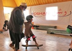 A Jogi elder helps as a boy skating for the first time. Skate Park, Have Fun, Classroom, Sport, Skating, Children, World, Photograph, Class Room
