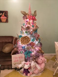 My unicorn tree. Spray painted it, added flowers, other decor, horn and ears. I hope this gets pinned a million times and I have inspired someone else on how to make a unicorn Christmas tree.