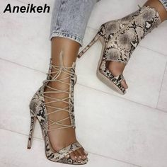 New arrival! *Online Exclusive... Buy it here now http://www.rkcollections.com/products/snake-skin-lace-up-stilettos?utm_campaign=social_autopilot&utm_source=pin&utm_medium=pin