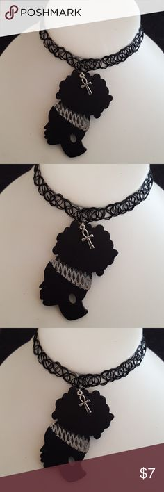 Black Side profile African Woman Tattoo choker Black simulated Tattoo Pinted Stretchable Side profile African Woman with her Afro Puff with top small silver ankh charm Choker.   Fits Small to Large Necklines.   14 inches to 24 inches Necklines.   Fits close to neck.  Very comfortable fit at any neck size.  Tattoo choker is made out of Lucite Thread/ Hyperallgenic. It will stretch right over your head and feel great on your neck. Jewelry Necklaces