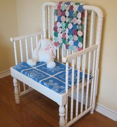 A bench made from a baby crib.