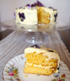 Orange, Rose and White Chocolate Cake - Orange and rose flavoured sponge, sandwiched together with orange jam and white chocolate buttercream, decorated with sugared violas and pelargoniums.