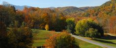Located on TN Hwy 143 at the base of the majestic 6,285 Roan Mountain, Roan Mountain State Park encompasses more than 2,000 acres dominated by rich hardwood forest along rugged ridges. The cool, clear