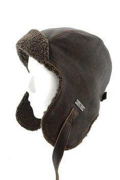 FUR WINTER Vintage Bull Leather Bomber Trapper Hat Helmet Cap BRN M. 60% Bull Leather, 40% Polyester;. Premium faux sheepskin shearing and genuine bull leather;. Easy pack and take away with fashion design;. Adjuster in back and metal leather tie closure system;. Quality lasts a long time and we carry custom sizes.