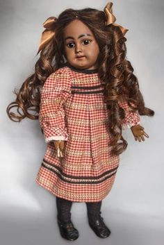 Isn't she Wonderful ! This model is rare to find in a Mocha Bisque. However, it is even rarer to find one as absolutely Adorable as this one is! She