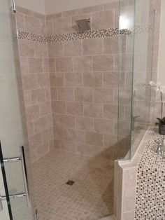 Wall Tile idea - maybe with vertical stripe     Master Bathroom tile shower in Tampa, Florida. 9x18 Porcelain wall tile with mixed mosaic (glass & travertine) by Ceramictec