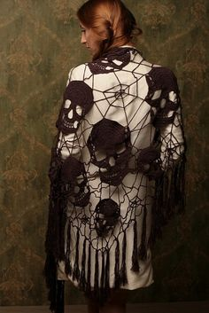 no pattern, but I love the idea - skull + spider web shawl.