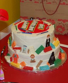 Just order a white cake and add Lego chocolates to it?