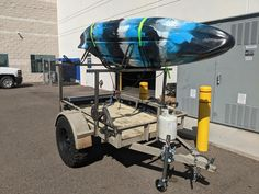 Nice example of setting a utility trailer up for bring kayaks on camping adventures. Trailer/photo by Mickey Jones