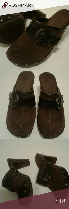 Clog Heels Clog Heels with a buckle on each heel Size 7 - Not able take a picture of the Size. Color: Brown  Good Used Condition  Small spot in the last picture, please check it out Shoes Mules & Clogs