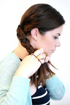 The Easiest Braided Updo Youll Ever Try Begin braiding your ponytail into a traditional three-strand braid. Secure with a hair elastic, then repeat with the remaining section.