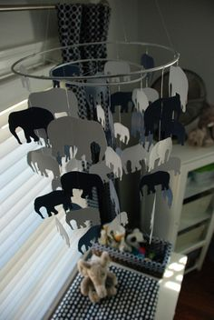 http://projectnursery.com/projects/baby-bees-navy-white-elephant-nursery/