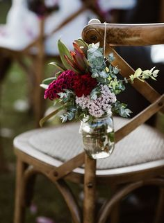 Rustic timber cross back chair with jar of pink and red flowers for outdoor wedd. Rustic timber cross back chair with jar of pink and red flowers for outdoor wedding ceremony seating Wedding Ceremony Ideas, Wedding Aisles, Outdoor Wedding Ceremonies, Outdoor Weddings, Winery Wedding Centerpieces, Arch Wedding, Outdoor Wedding Photography, Baby Wedding, Photography Flowers