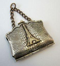 Paris souvenir handbag charm with pullout pictures inside.