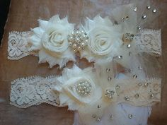 Wedding Garter and Toss Garter Set - Ivory Flowers on a Ivory Lace with Tulle Bows with Crystal Rhinestones & Pearls - Style 3000: $23.50. This Etsy shop is very affordable and it has a lot of beautiful wedding pieces.