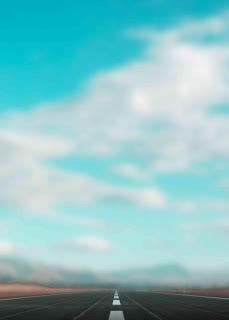 Blue hd sky with road blur background stock image. It is fully blurred sky background for editing. You can easily make photo editing with this background.