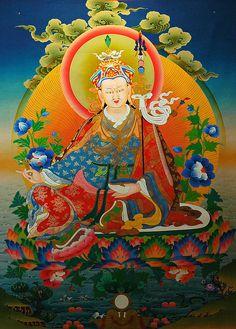Padmasambhava, Guru Rinpoche seated on a moon lotus, with vajra, skullcup, khatvanga staff, blue lotuses, vulture feather hat, 7 robes,Tibetan Thangka, 8th Century Saint, from a shop in Bodha, Kathmandu, Nepal by Wonderlane, via Flickr