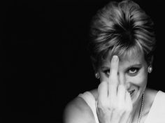 Princess Diana, strong woman whose candled burned strongly but, for too short a time.  Such a playful photo.  You have to wonder who she is flipping off? The possibilities are endless!