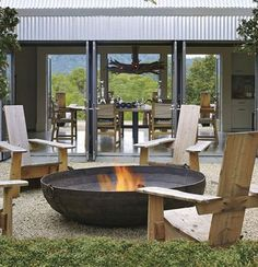 Build a unique outdoor fire pit seating using our spectacular ideas for circular, sunken & built in area designs for patio, garden & backyard. Rustic Fire Pits, Metal Fire Pit, Diy Fire Pit, Fire Pit Backyard, Outdoor Fire, Outdoor Living, Desgin, Fire Pit Materials, Fire Pit Furniture