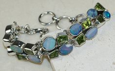 Fire Opal,Peridot Faceted  bracelet designed and created by Sizzling Silver. Please visit  www.sizzlingsilver.com. Product code: BR- 8726