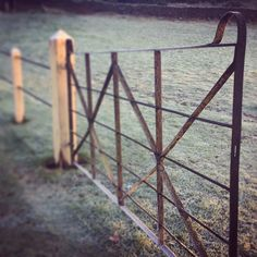"""Oak fencing Shottle, Derbyshire 7X7"""" Green Oak with 20mm iron bar drilled through each piece, painted with Hammerite paint and an old gate hung on 9x9"""" Oak, all suk into the ground 2ft"""