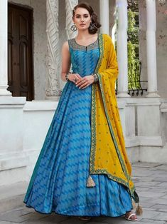 Marvellous blue digital printed gown online at best shopping price. Shop this latest gown style for diwali celebration. This alluring style set comprises a silk gown with matching chiffon dupatta.
