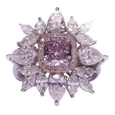 Fancy Pink Purple Diamond Ring at 1stdibs 1.28 CT fancy purple pink diamond in the center surrounded by 3.50 ct of marque and pear shape combination.