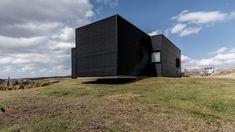 Perspectiva casa de campo con paneles de metal corrugado