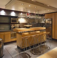 LOVE THIS KITCHEN!!  Brown Modern-Contemporary Kitchen  Four bar stools at a breakfast bar island.